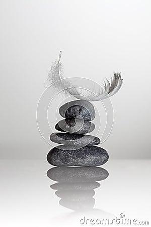 Feather over zen stones