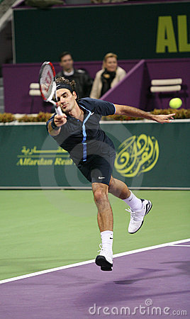 Federer runs for the ball in Qatar Editorial Stock Photo