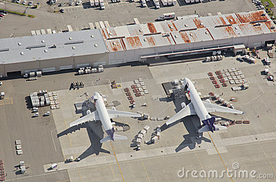 FedEx Airliners Unloading at Busy Airport Editorial Stock Image
