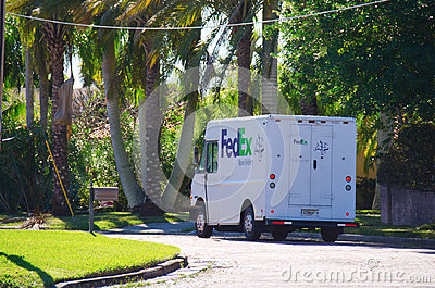 FedEx delivery truck doing a residential delivery Editorial Image