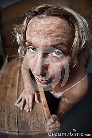 Fedup woman sanding furniture