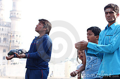 Feeding the pigeons near Charminar Editorial Stock Image