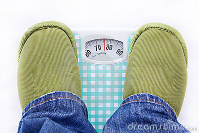 Feet on a bathroom scale showing weight