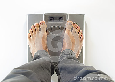 Feet on a bathroom scale slim
