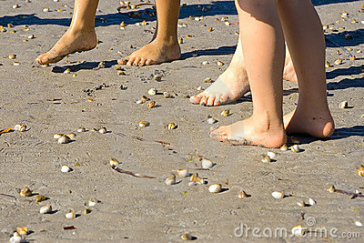 Feet on the beach at summer
