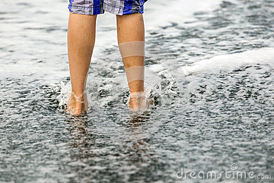 Feet of boy at the beach