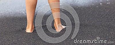 Feet of boy at the black beach in Lanzarote, Spain