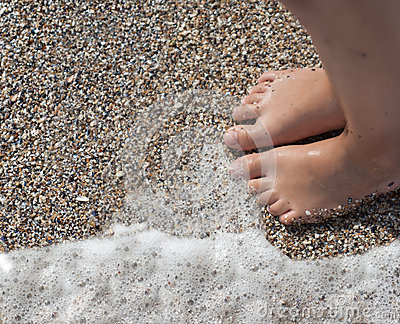 Feet of child on the beach