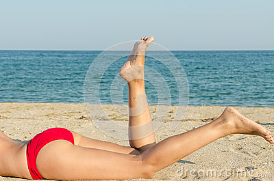 Feet Closeup Of Young Girl On Holiday Relaxing On Beach