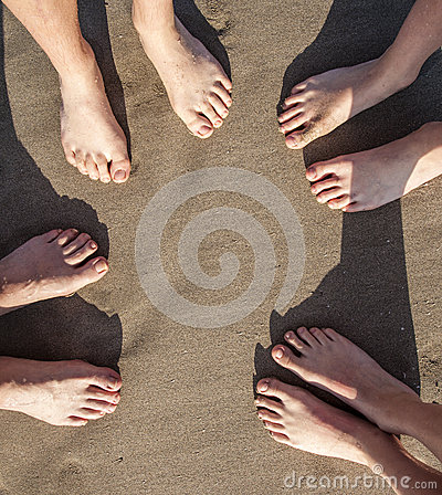 Feet of four Persons at the beach