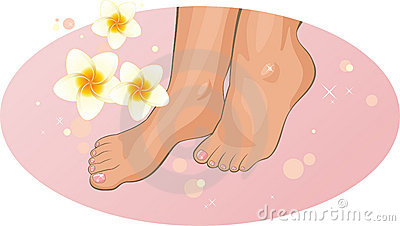 Feet with frangipani flowers in the SPA
