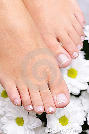 Feet with the French pedicure and flowers