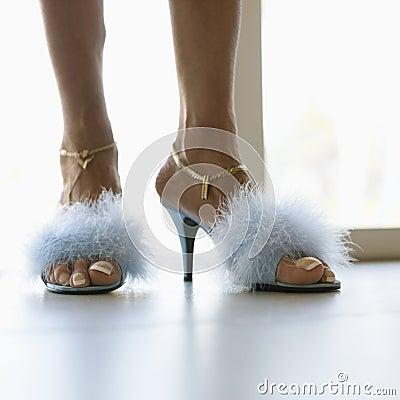 Feet in furry heels.