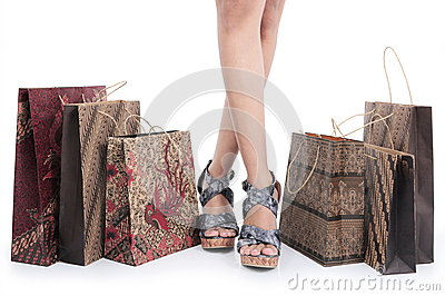 Feet of a girl and batik shopping bags