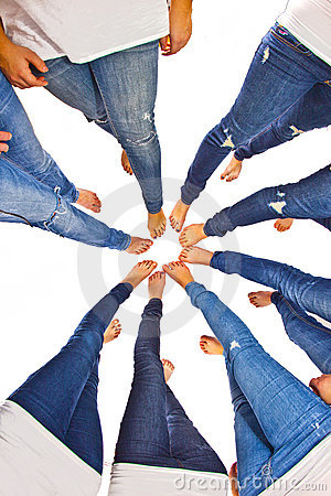 Feet of girls with jeans in a circle