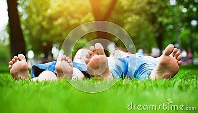 Feet on grass. Family picnic in spring park
