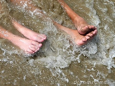 Feet in the ocean surf