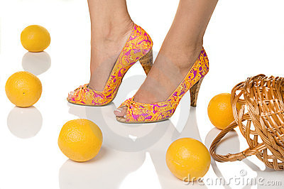 Feet with pedicure and oranges