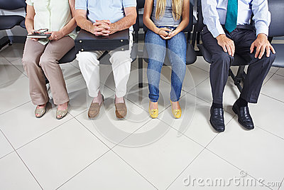 Feet of people in waiting room