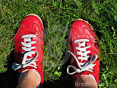 Feet of person in red sneakers