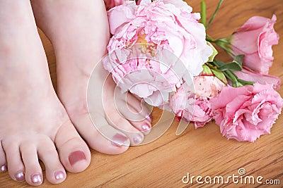 Feet with pink nail polish