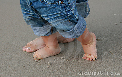 Feet on sand - first baby s step