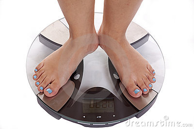 Feet on scales blue toenails