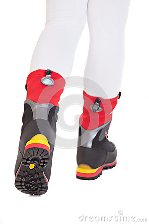 The feet shod in special tourist shoes for climbing mountains
