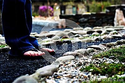 Feet on a stone path