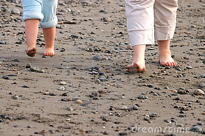 Feet on stony beach