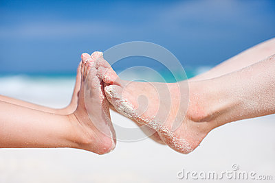 Feet on tropical sand