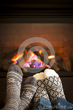 Free Feet Warming By Fireplace Royalty Free Stock Photography - 31495807