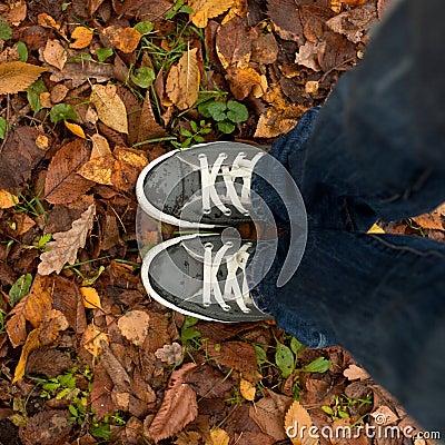 Feet in wet sneakers