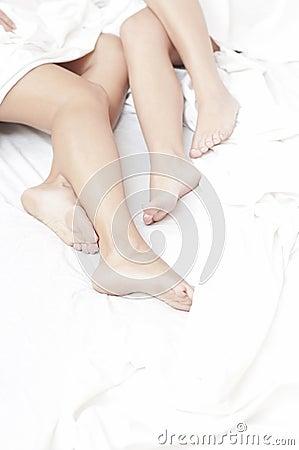 Feet of women in bed
