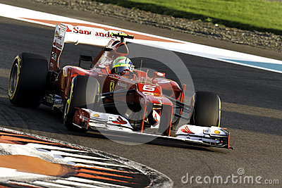 Felipe Massa cornering a Ferrari F1 car at Yas Marina race track Abu Dhabi Editorial Photography