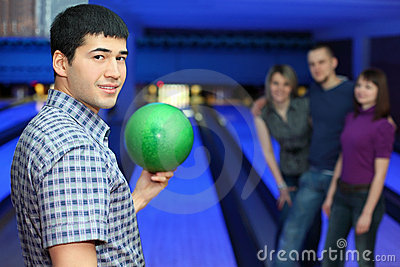 Fellow holds ball for bowling friends hearten him