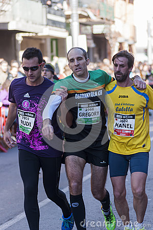 Fellowship among runners, Mitja Marato Granollers Editorial Stock Image