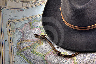 Felt hat over vintage, warn out map of South Ameri