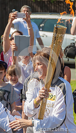 Female 2012 Olympics Torch Bearer. Editorial Photo