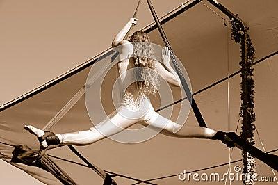 Female Aerial Acrobat Doing Splits
