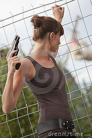 Female agent with gun