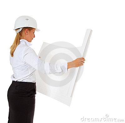 Female architect checking blueprint