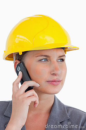 Female architect on her cellphone with helmet on