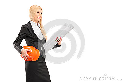 Female architect holding a helmet and a blueprint