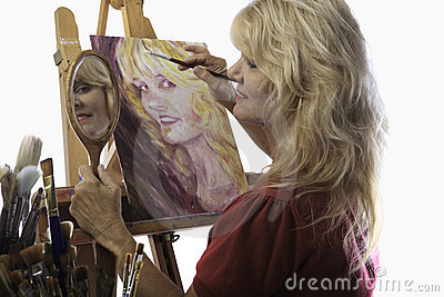 Female artist in her fifties painting