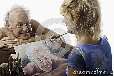Female artist painting a portrait