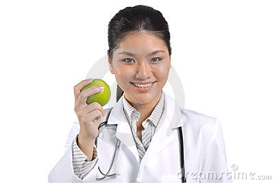 Female Asian doctor holding an apple.