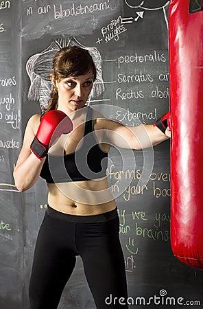 Female athlete hitting a punching bag