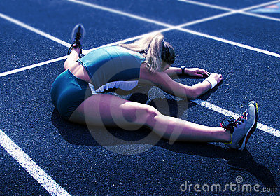 Female Athlete Stretching on Track