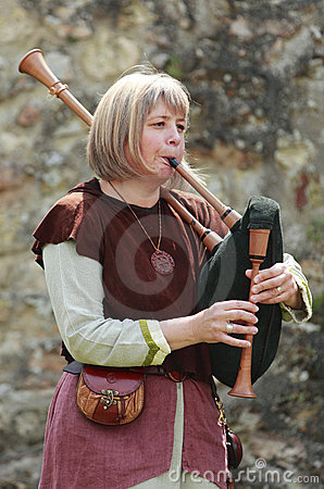 Female bagpiper Editorial Stock Photo